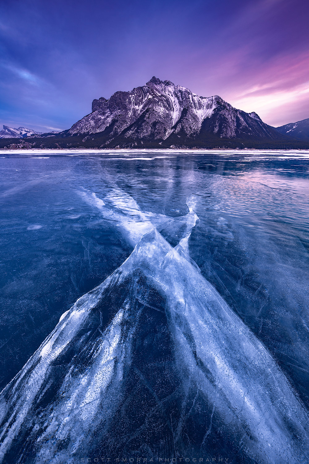 Fine Art Limited Edition of 50 - Sunset light above the mountains and amazing winter ice formations at Abraham Lake, Alberta...