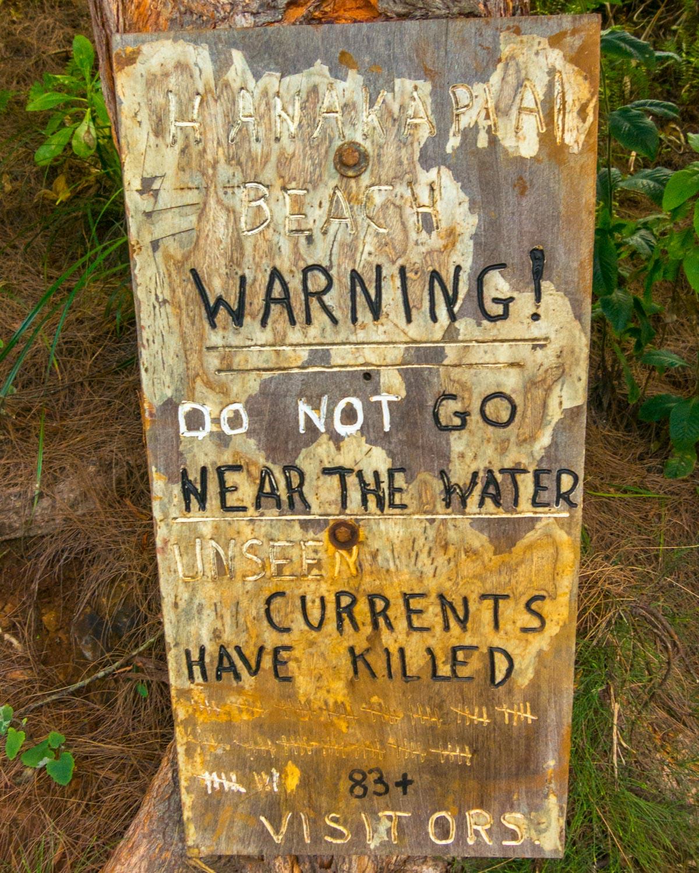 Warning sign at Hanakapi'ai Beach on the Kalalau Trail, Kaua'i, Hawaii