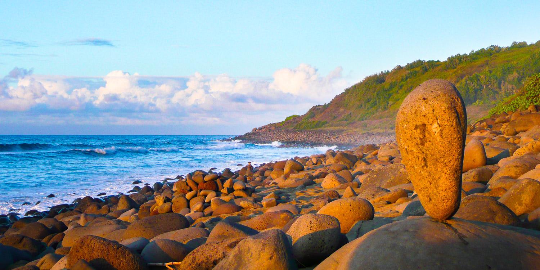 Rock art at Kalalau Beach on the Napali Coast of Kaua'i, Hawaii.