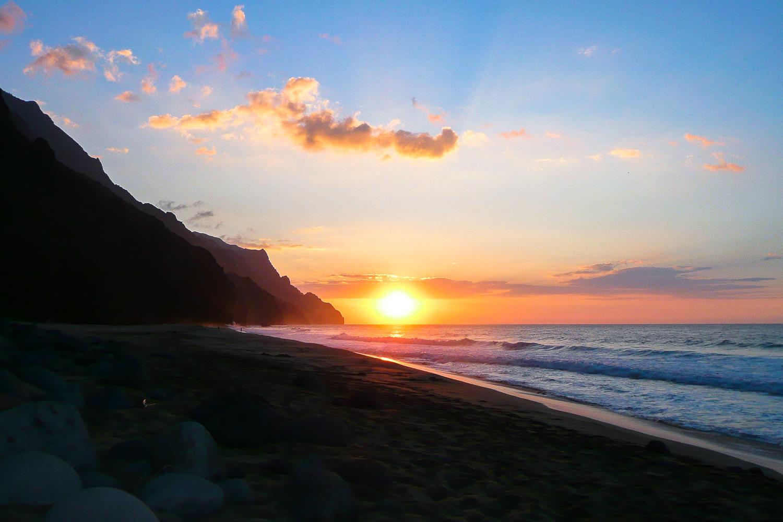Sunset at Kalalau Beach on the Napali Coast of Kaua'i, Hawaii.