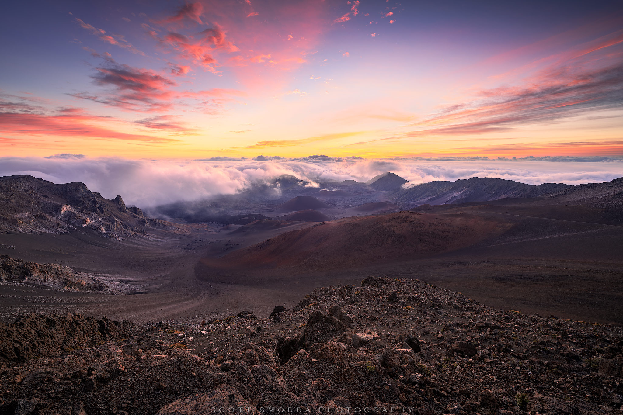Fine Art Limited Edition of 100 - Beautiful sunrise light illuminates wispy tropical clouds above the volcanic crater of Haleakala...