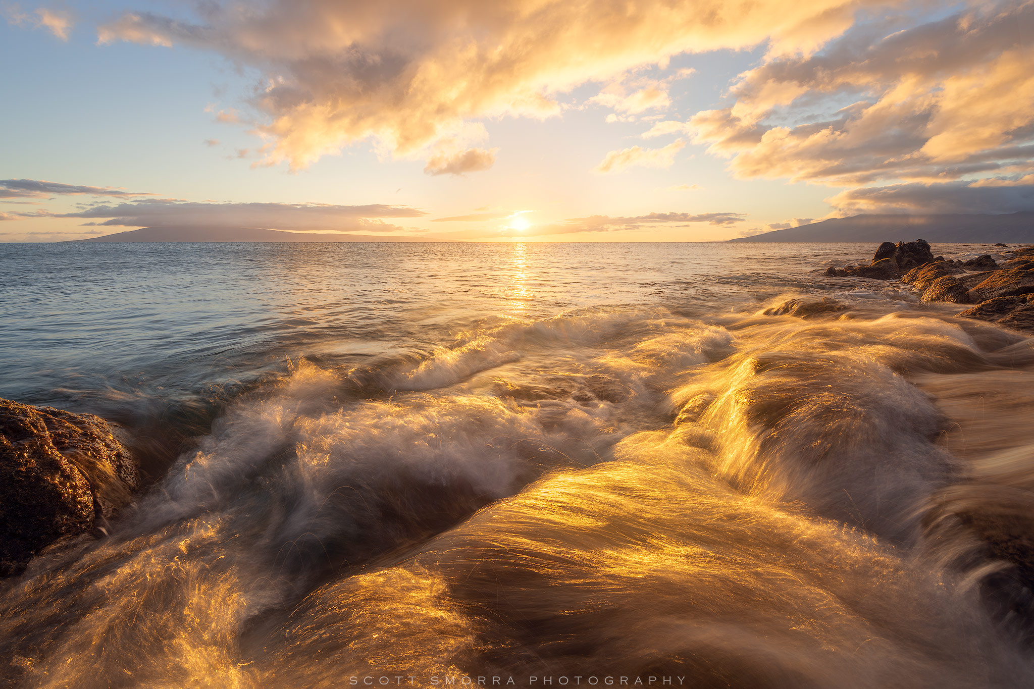 Fine Art Limited Edition of 100 - Golden sunlight illuminates rushing water and waves near Kapalua, Maui, Hawaii.  This image...