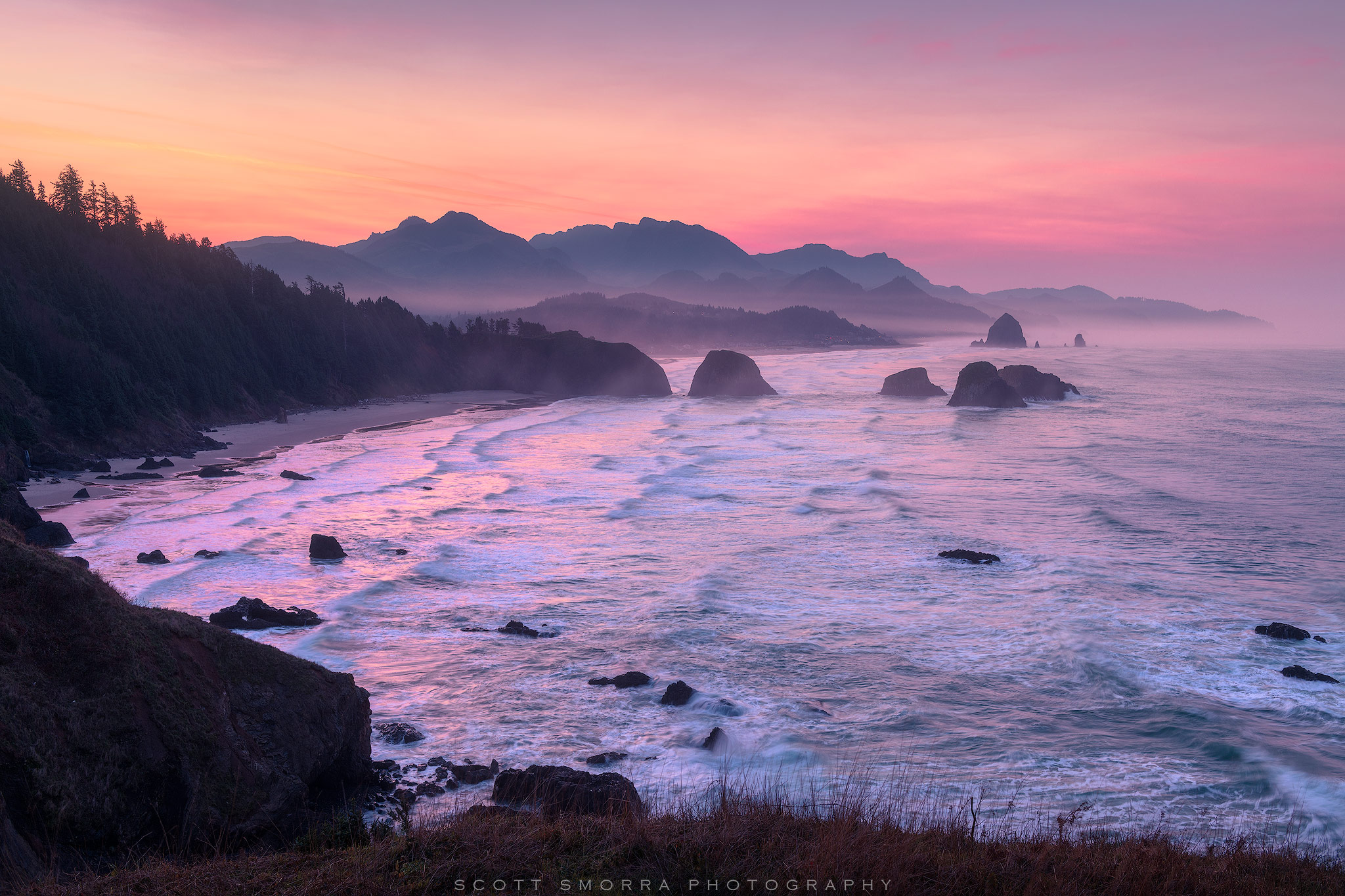 Fine Art Limited Edition of 50 - Sunrise light fills the sky above Ecola State Park and Cannon Beach on the Oregon Coast. The...