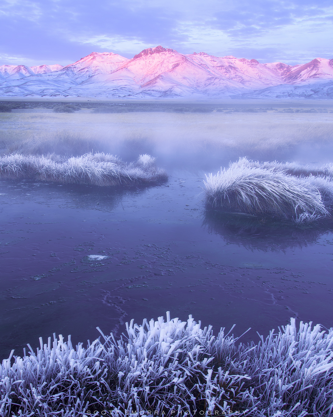 Fine Art Limited Edition of 100 - The first touch of sunrise light shines upon Steens Mountain above a steamy Borax Hot Springs...