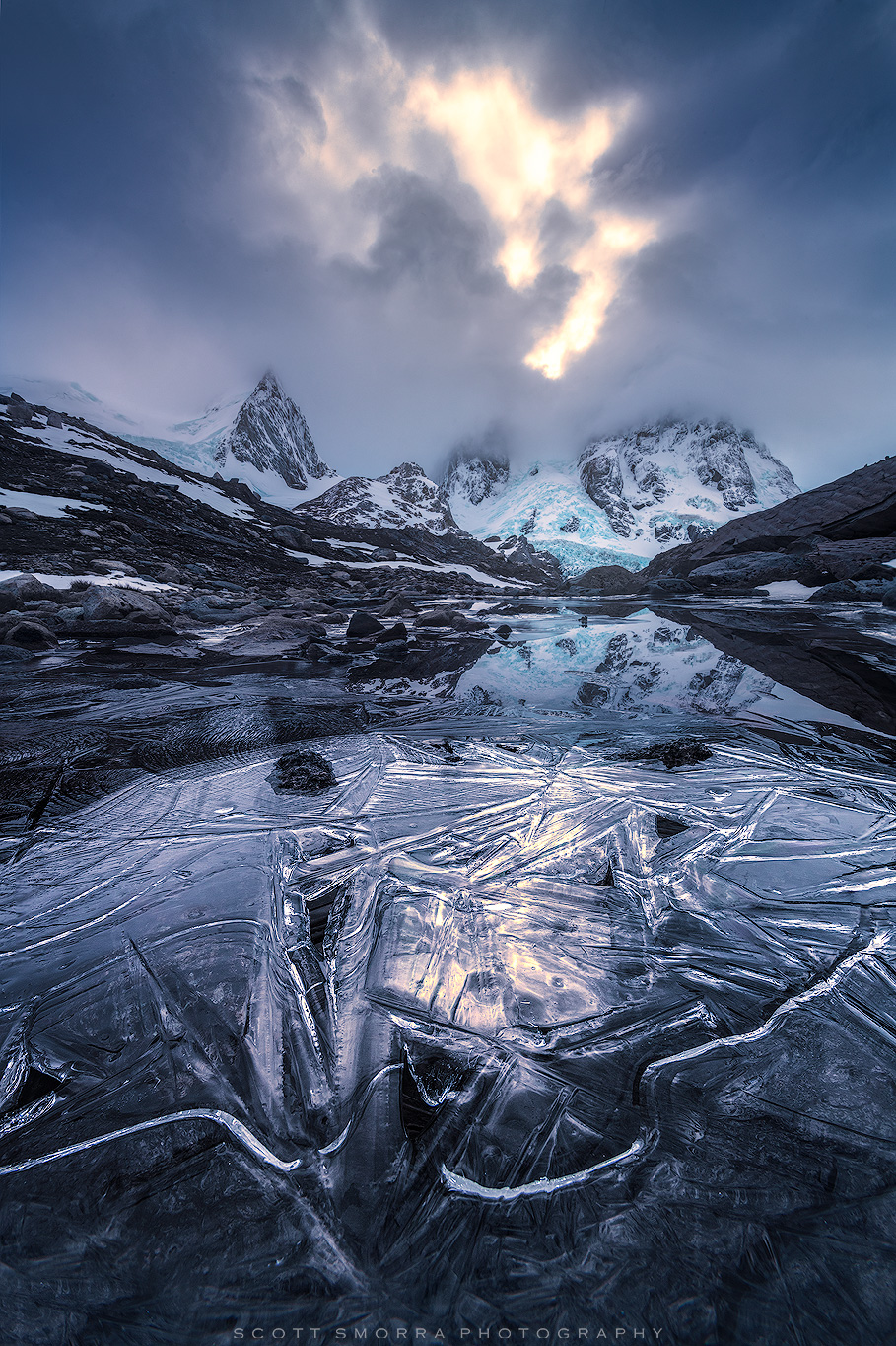 Fine Art Limited Edition of 50 - Ice patterns on the surface of a small alpine tarn lead back to glaciers and towering peaks...