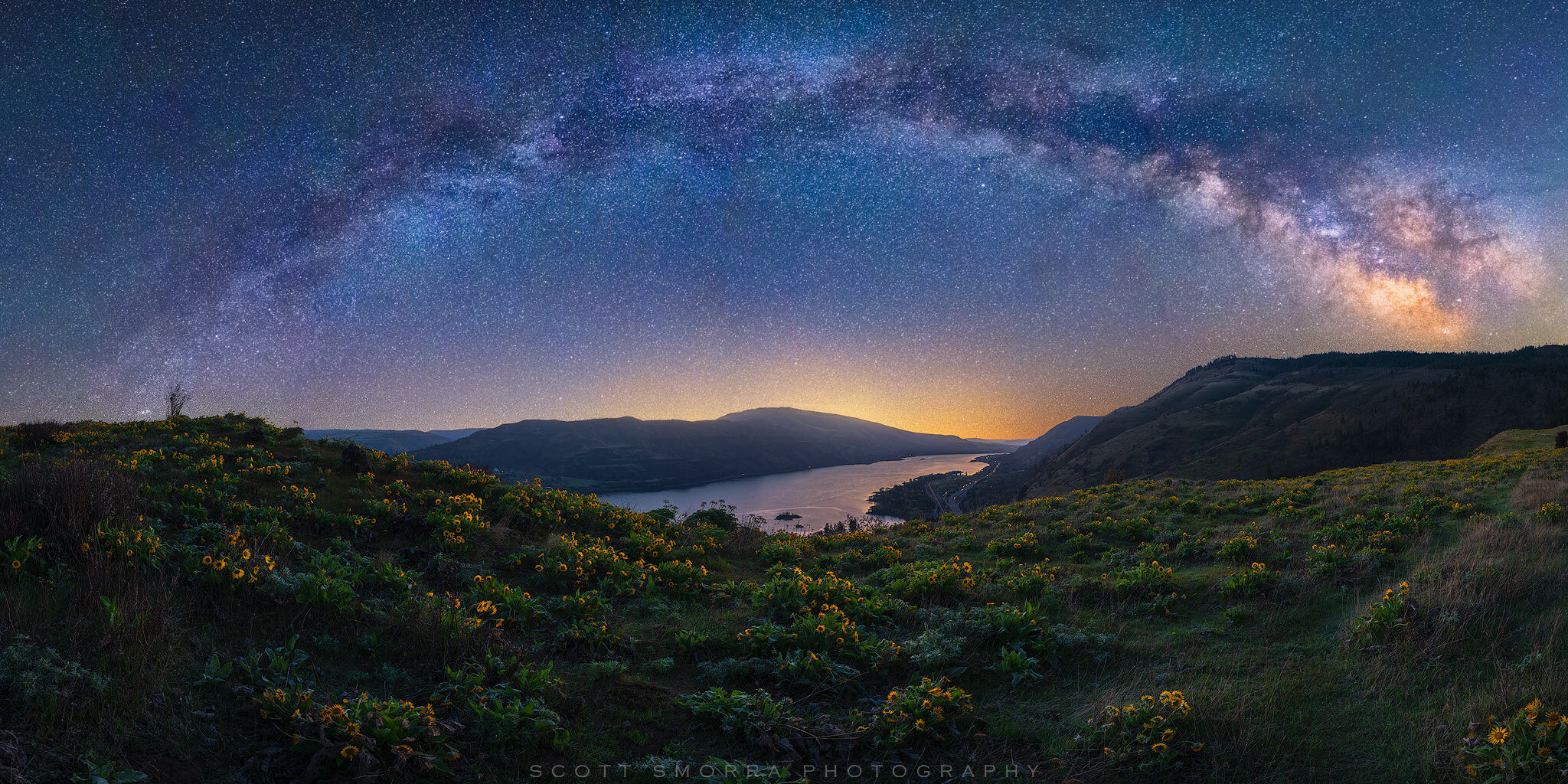 The Milky Way and billions of stars shine above the Columbia River Gorge in Oregon in this springtime panoramic photo.