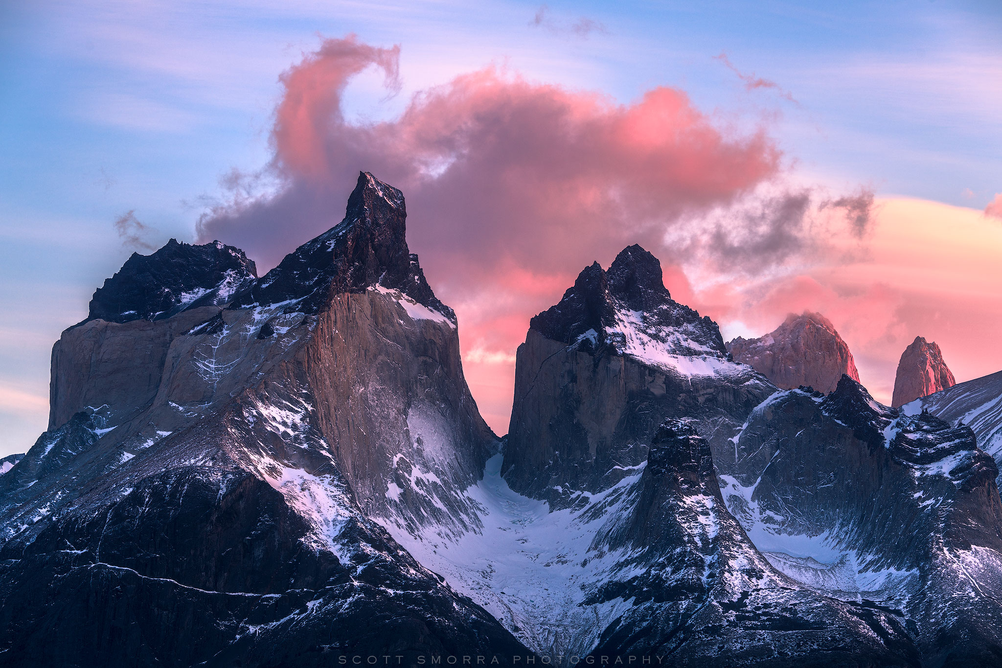 Fine Art Limited Edition of 50 - A cloud formation shaped like a scorpion tail drifts above the Cuernos del Paine at sunrise...