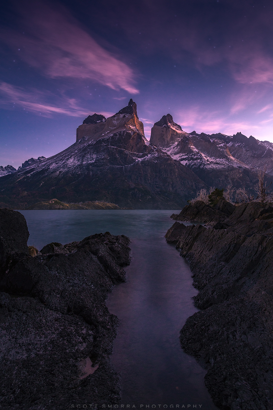 Fine Art Limited Edition of 50 - Early sunrise light illuminates high clouds in a sky full of stars above Cuernos del Paine (...
