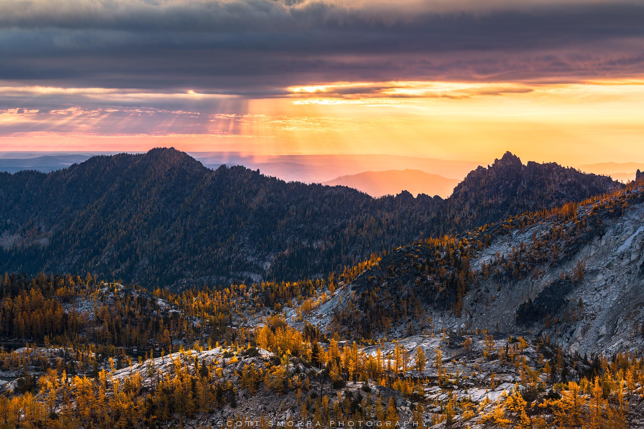 Fine Art Limited Edition of 25 - Sunrise light filtering down through mid level clouds in the Enchantments of the Washington...