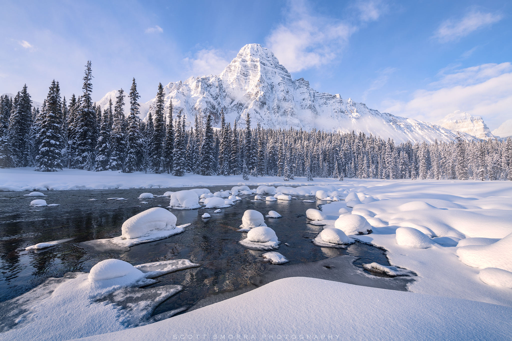 Fine Art Limited Edition of 100 - Early morning light shines upon a mountain and small stream in the backcountry of Banff National...