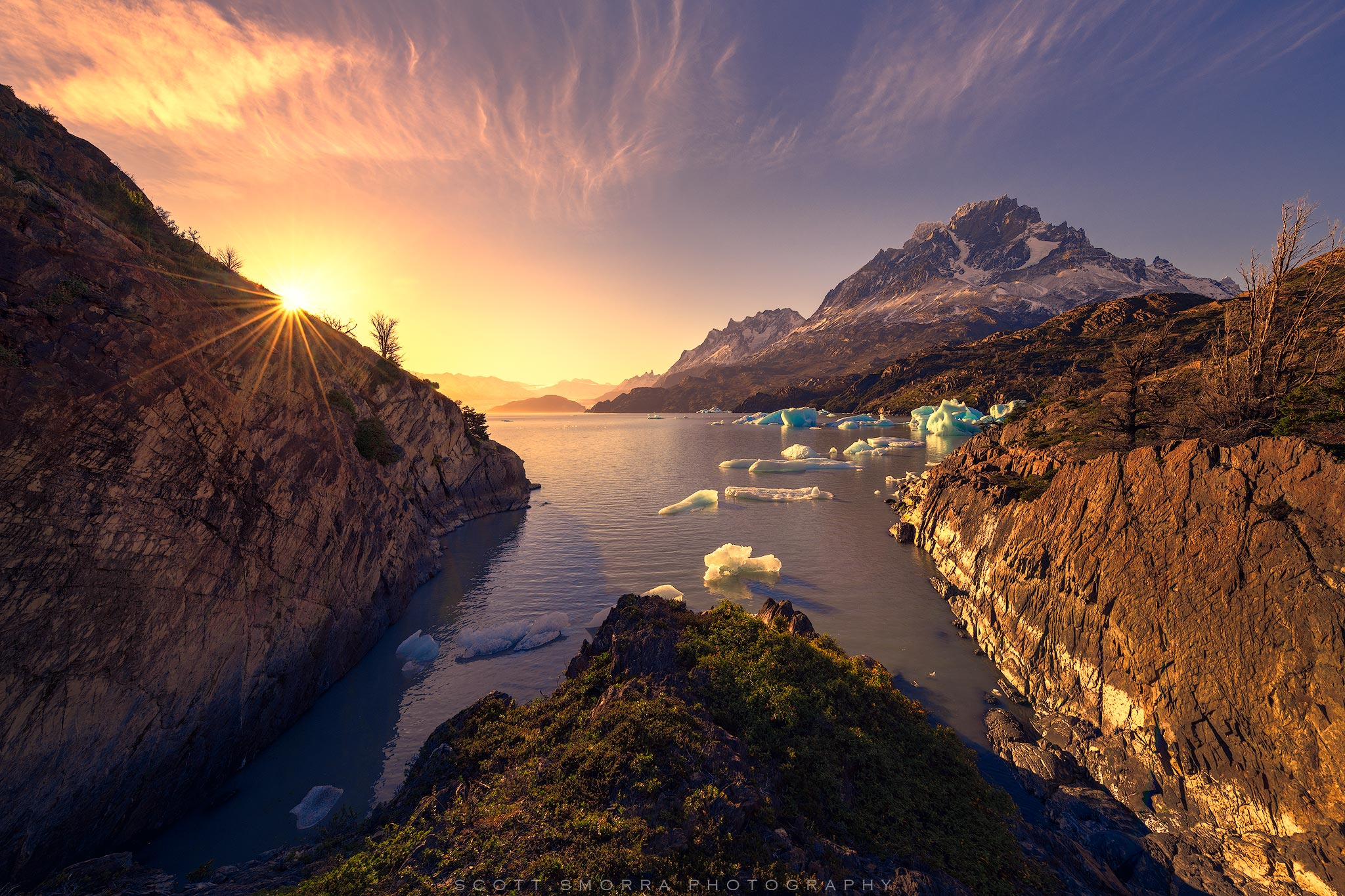 Fine Art Limited Edition of 50 - Sunset light illuminates an iceberg filled bay in Parque Nacional Torres del Paine, Chile. ©...